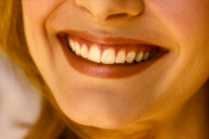 A up close picture of a woman's smile.
